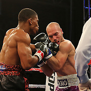 TAMPA, FL - FEBRUARY 28:  Clarence Booth (L) punches Osenohad Vazquez with a left hook during the SoloBoxeo Tecate boxing match at the University of South Florida Sundome on February 28, 2015 in Tampa, Florida. Booth won the bout by knockout.  (Photo by Alex Menendez/Getty Images) *** Local Caption *** Clarence Booth; Osenohad Vazquez