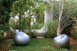 Garden seats by Finn Stone. Silver birch, MIscanthus 'Zebrinus' and large concrete structure.