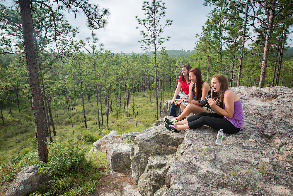 From left, Amanda Dyson, Megan Boles and Heidi Boles enjoy the view during a break while hiking along the Longleaf Vista Recreation Area interpretative trail. The recreation area is located along the Longleaf Vista Scenic Byway. The byway offers natural beauty as well as access to trailheads, camping sites and scenic views.