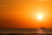 Fishing boat in North Sea at sunset, Germany