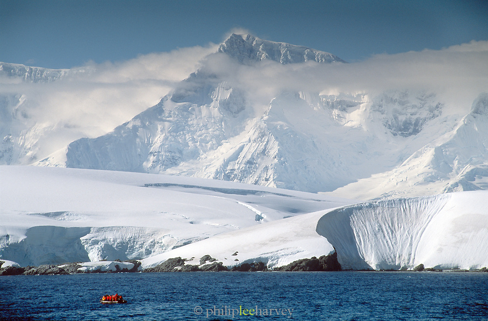 Tourists view the Antacrtic Peninsula from an Inflatable Zodiac craft, Antarctica