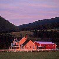 The day's last light illuminates houses in Montana's Gallatin Valley, near Bozeman.
