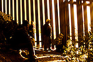 """Tijuana 2015.<br /> A group of migrant is waiting the right moment to """"jump on the other side"""". Foggy days are the only days to do it.<br /> <br /> Un gruppo di migranti aspettano il momento giusto per passare la frontiera nella nebbia."""