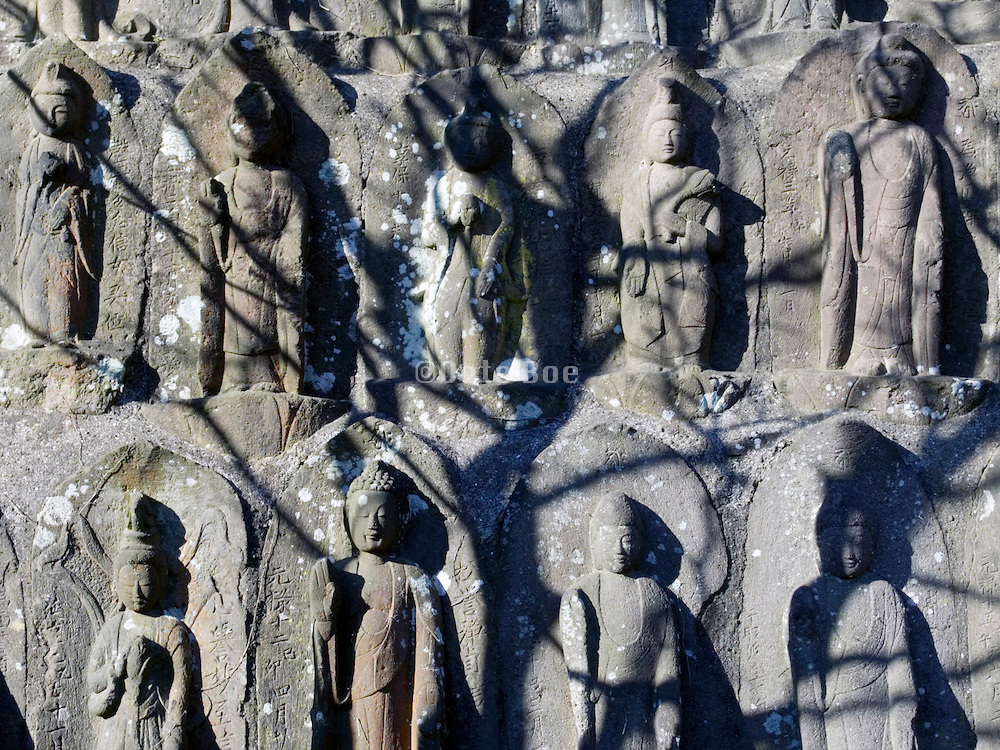 close up of many little Jizo figures at a temple Japan