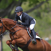 Michael Desiderio riding Temptation in action during the $100,000 Empire State Grand Prix presented by the Kincade Group during the Old Salem Farm Spring Horse Show, North Salem, New York,  USA. 17th May 2015. Photo Tim Clayton