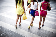 "Chinese women cross the street in the city centre of Chengdu, China, August 4, 2014.<br />   <br /> This picture is part of the series ""Urban Chinese Streets"", a journey on the streets of Chinese cities to discover their modern citizens and habits.    <br /> <br /> © Giorgio Perottino"