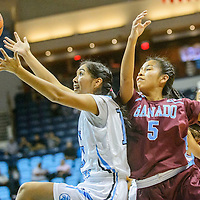 Window Rock Scout Kimberly Pablo (13), left, reaches for a rebound ahead of Ganado Hornet Camille Uentillie (5) during the Tournament of Champions at the Window Rock Scout Event Center in Fort Defiance Wednesday
