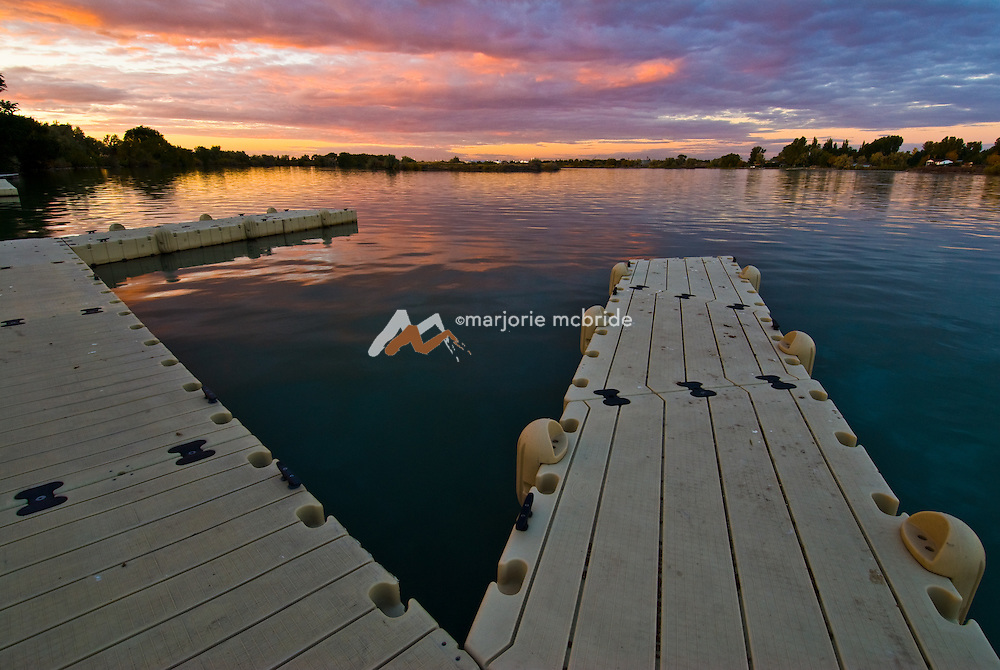 Idaho, Cassia County, Burley. Sunset over docks on the Snake River.