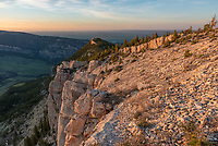 The last sunlight of the evening shines on the cliffs north of Steamboat Point in the Bighorn Mountains.