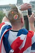 April 29th 2011 Royal Wedding. Trafalgar Square. Man wearing Burger King crown and Union Jack.