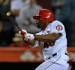 NAHEIM, California/USA (Tuesday, September 26, 2012) - Los Angeles Angels outfielder Torii Hunter gets his 10th career walk-off hit, an RBI single that gave the Angels a 4-3 victory during the Mariners vs Angels game held at the Angels Stadium. Byline and/or web usage link must read PHOTO © Eduardo E. Silva/SILVEX.PHOTOSHELTER.COM.