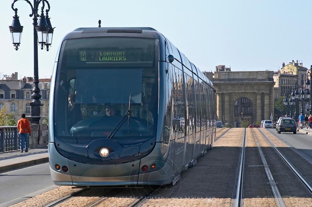 The old bridge Pont de Pierre. Porte Bourgogne or des Salinieres. The modern tram. Bordeaux city, Aquitaine, Gironde, France