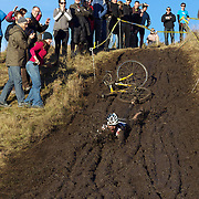 Mike Kelly falls from his bike and slides down the muddy hillside during the thrills and spills of the New Zealand Cyclocross Championships sponsored by AJ Hackett Bungy, held at Jardine Park,  Queenstown, as part of the Queenstown WInter Festival. The men's event was won by Dan Warren from Hastings while Anja McDonald from Dunedin won the women's event. Queenstown, New Zealand, 2nd July 2011