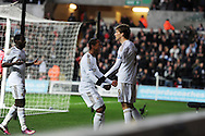 Swansea city's Michu ® celebrates with Jonathan de Guzman © and Nathan Dyer (l) after he scores the 1st goal. Barclays Premier league, Swansea city v Queens Park Rangers at the Liberty Stadium in Swansea, South Wales on Saturday  9th Feb 2013. pic by Andrew Orchard, Andrew Orchard sports photography,