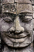 One of the carved faces that may represent  Jayavarman the third, who was ruler at the time of construction of the Bayon temple in the Angkor Archeological Park in Siem Riep. Cambodia. August 2002