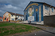 Wall mural of Fallen comrades on an end terrace of a house in Shankill, Belfast. Depicting Lt Col William Bucky McCullough - 2nd Batt U. F. F West Belfast Brigade.