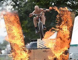 © Licensed to London News Pictures.03/08/2016. Thornton Le Dale, UK.  Joseph Peace demonstrates his spectacular fire stunts at the annual Thornton-le-Dale Show, Pickering, North Yorkshire.  Photo credit: Anna Gowthorpe/LNP