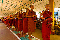 Procession of monks walking to lunch at the Kya Khat Winne Monastery<br /> Location: Bago, Myanmar (Burma)