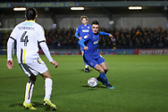 AFC Wimbledon midfielder Anthony Hartigan (8) dribbling and about to take on Burton Albion midfielder Ryan Edwards (4) during the EFL Sky Bet League 1 match between AFC Wimbledon and Burton Albion at the Cherry Red Records Stadium, Kingston, England on 28 January 2020.