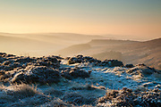 A wintery dawn from near Upper Burbage Bridge, looking towards Carl Wark and Hathersage Moor. Peak District.