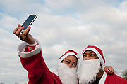 Victoria Park , East London. December 8th 2013, Santa Run in aid of different charities, organised by 'Doitforcharity'.