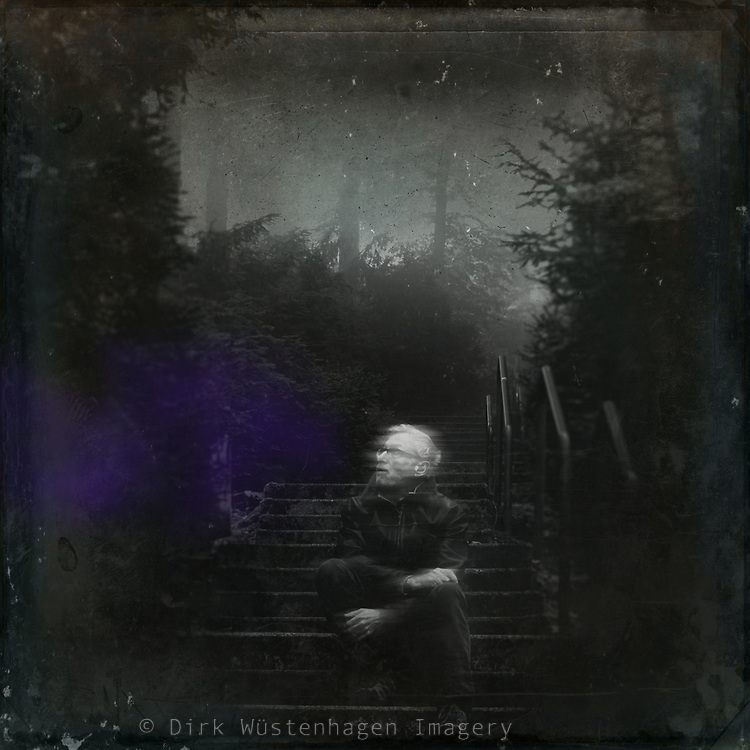 Man sitting on the bottom of a stairway alone