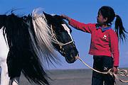 Nomads child with horse<br /> Gobi Desert<br /> Mongolia