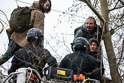 Steeple Claydon, UK. 23 February, 2021. National Eviction Team bailiffs acting for HS2 Ltd use a cherry picker to attempt to evict activists opposed to the HS2 high-speed rail link from ancient woodland known as Poors Piece. The activists created the Poors Piece Conservation Project there in spring 2020 after having been invited to stay on the land by its owner, farmer Clive Higgins. Already, local village communities have been hugely impacted by HS2, with 550 acres of land seized including a large section of a nature reserve.