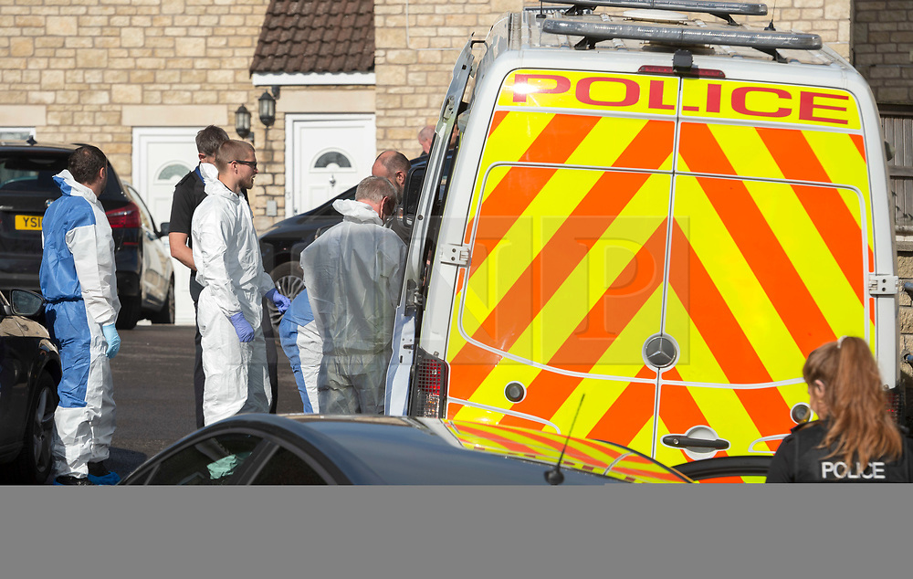 © Licensed to London News Pictures; 22/08/2020; Paulton, Bath and North East Somerset, UK. Police personnel search a house in Paulton after a man was arrested as part of an investigation by officers from Counter Terrorism Policing South East and South West. The man aged 33 was first arrested on Thursday (20/8) on suspicion of making or possessing an explosive substance in suspicious circumstances. He was then re-arrested on Friday (21/8) under section 41 of the Terrorism Act 2000 by detectives from Counter Terrorism Policing South East and South West. Officers carrying out this search are wearing protective suits due to the nature of this investigation and the Explosive Ordnance Disposal Team had been present at the property as a precaution. Police have said there is no wider threat to the public. Photo credit: Simon Chapman/LNP.