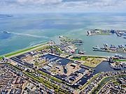Nederland, Noord-Holland, gemeente Den Helder, 07-05-2021; Zicht op Willemsoord - Oude Rijkswerf van de Koninklijke Marine. Op het terrein is het nieuwe droogdok, dok II, duidelijk te herkennen. Zicht op de TESO veerhaven, de veerpont naar Texel is zojuist vertrokken. Texel aan de horizon. View of the TESO ferry port, the ferry to Texel has just left. Texel on the horizon.<br /> View of Willemsoord - Old Royal Yard of the Royal Navy. The new dry dock, dock II, is clearly recognizable.<br /> luchtfoto (toeslag op standard tarieven);<br /> aerial photo (additional fee required)<br /> copyright © 2021 foto/photo Siebe Swart