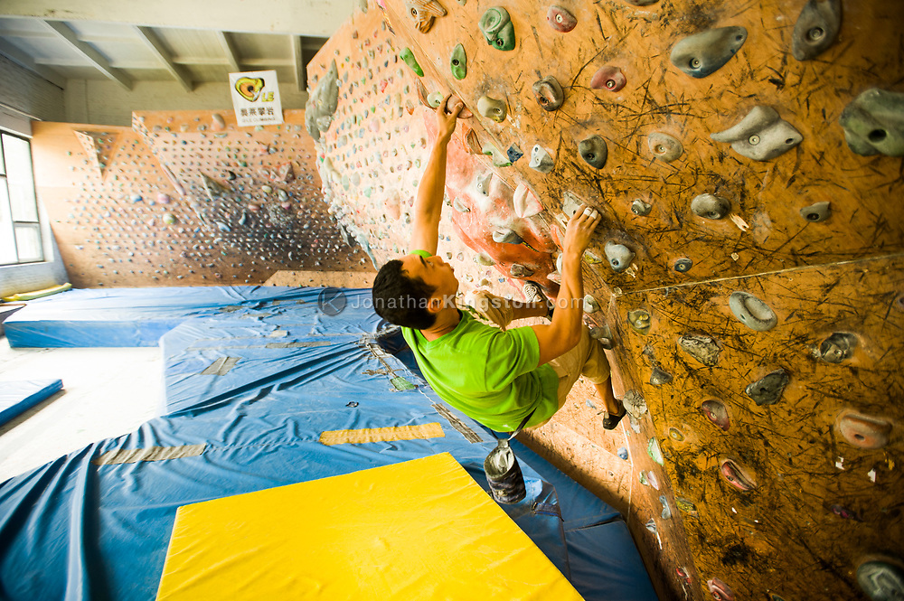 A rock climber works out in a climbing gym in Beijing, China (Model Released, Sean Ouyang).
