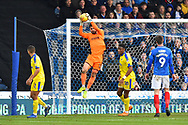 Tom King (1) of AFC Wimbledon catches the ball during the EFL Sky Bet League 1 match between Portsmouth and AFC Wimbledon at Fratton Park, Portsmouth, England on 1 January 2019.