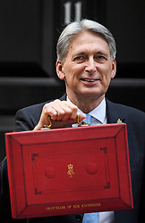 © Licensed to London News Pictures. 29/10/2018. London, UK. Chancellor PHILIP HAMMOND holds his red dispatch box on the steps of Number 11 Downing Street in London, before presenting his Budget to Parliament. This will be the last budget before the UK is due to exit the European Union in March of 2019. Photo credit: Ben Cawthra/LNP