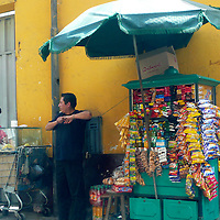 South America, Peru, Lima. Street vendor selling snack foods in Lima, Peru.