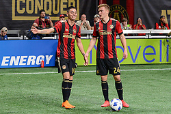 March 11, 2018 - Atlanta, GA, U.S. - ATLANTA, GA Ð MARCH 11:  Atlanta United's Miguel Almiron (10) and Julian Gressel (24) discuss which way to kick the ball prior to a free kick during the match between DC United and Atlanta United on March 11, 2018 at Mercedes-Benz Stadium in Atlanta, GA.  Atlanta United FC defeated DC United by a score of 3 - 1.  (Photo by Rich von Biberstein/Icon Sportswire) (Credit Image: © Rich Von Biberstein/Icon SMI via ZUMA Press)