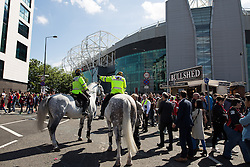 © Licensed to London News Pictures. 15/05/2016. Manchester, UK. The scene where part of Old Trafford Stadium has been evacuated before Manchester United's final-day match against Bournemouth, due to a suspect package being found. Photo credit: Joel Goodman/LNP