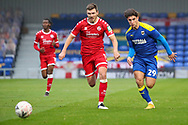 AFC Wimbledon attacker Ryan Longman (29) chasing through ball with Crawley Town defender Jordan Tunnicliffe (19) during the The FA Cup match between AFC Wimbledon and Crawley Town at Plough Lane, London, United Kingdom on 29 November 2020.