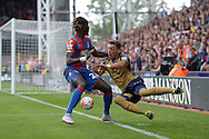 Pape N'Diaye Souare of Crystal Palace fouls Mesut Ozil of Arsenal. Barclays Premier league match, Crystal Palace v Arsenal at  Selhurst Park in London on Sunday 16th August 2015.<br /> pic by John Patrick Fletcher, Andrew Orchard sports photography.