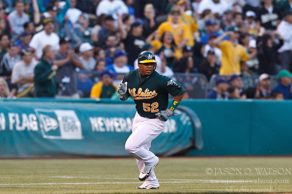 OAKLAND, CA - JUNE 20: Yoenis Cespedes #52 of the Oakland Athletics rounds third base to score a run against the Los Angeles Dodgers during the fourth inning of an interleague game at O.co Coliseum on June 20, 2012 in Oakland, California. The Oakland Athletics defeated the Los Angeles Dodgers 4-1. (Photo by Jason O. Watson/Getty Images) *** Local Caption *** Yoenis Cespedes