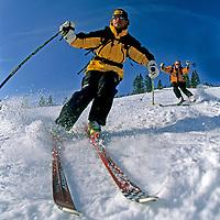 SKIING, Montana. Patrick Shanahan & Bobby Model (MR), cruise deserted Toni Matt run at The Big Mountain Ski Area, Whitefish.
