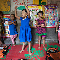 Mohona Hanif (centre) with her classmates in a small school in the Outfall Slum in Dhaka, Bangladesh. North American aid group World Renew supports her family through local organisation SATHI.