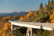 """The Linville Cove Viaduct is one of the most beautiful stretches of road in North America. It was completed in 1987 and was """"one of the most elegant solutions to an environmentally formidable problem, yet designed by the hand of man."""" The viaduct was the last 7.5 miles completed of the Blue Ridge Parkway. Built at an elevation of 4100 ft, the engineers put the pilings in place, and then placed pre-made sections of the 1,243 foot long S curve in place. """"So sensitive were the project engineers to the structures of environmental design that the only trees cut were those directly beneath the roadway."""""""