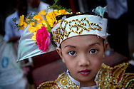 Portrait of a young street performer in downtown Yangon, Myanmar, Southeast Asia