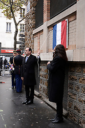French President François Hollande, with Paris Mayor Anne Hidalgo, presides over a ceremony to commemorate the first anniversary of the November 2015 terrorist attacks, La Belle Equipe restaurant in Paris, France on November 13, 2016. 130 people lost their lives during the attacks on 13 November 2015. Photo by Eliot Blondet/ABACAPRESS.COM