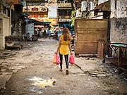 05 JUNE 2015 - KUALA LUMPUR, MALAYSIA: A woman leaves a wet market near the Chinatown section of Kuala Lumpur.     PHOTO BY JACK KURTZ