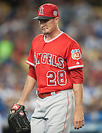 Angels' starter Andrew Heaney walks to the dugout after allowing the Dodgers to tie the game in the fifth inning during the Angels' Freeway Series game against the Dodgers Thursday night at Dodger Stadium.<br /> <br /> ///ADDITIONAL INFO:   <br /> <br /> freeway.0401.kjs  ---  Photo by KEVIN SULLIVAN / Orange County Register  --  3/31/16<br /> <br /> The Los Angeles Angels take on the Los Angeles Dodgers at Dodger Stadium during the Freeway Series Thursday.<br /> <br /> <br />  3/31/16