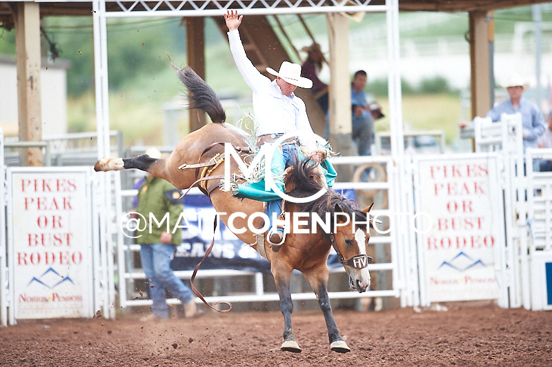 Saddle bronc rider Blaze Hamaker of Centennial, WY rides Little Miss at the Pikes Peak or Bust Rodeo in Colorado Springs, CO.<br /> <br /> <br /> UNEDITED LOW-RES PREVIEW<br /> <br /> <br /> File shown may be an unedited low resolution version used as a proof only. All prints are 100% guaranteed for quality. Sizes 8x10+ come with a version for personal social media. I am currently not selling downloads for commercial/brand use.