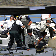 The crew of Black Jack work the rigging as Yacht's compete in The Rolex Trophy 2008 Rating series run by The Cruising Yacht Club of Australia on December 20, 2008 in Sydney, Australia. The racing series, conducted in the waters around Sydney, is a preliminary tournament to the Rolex Sydney Hobart Yacht race 2008 which will start of Boxing Day, December 26th. Over 100 yacht's are entered in this years race with spectators on the Sydney Harbour foreshore estimated to reach around 500,000 people. Photo Tim Clayton