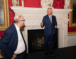 Arthur Edwards looks to the Prince of Wales as he speaks during a tea party held at Spencer House in London to celebrate 70 inspirational people marking their 70th birthday this year.