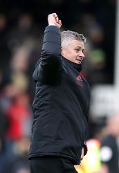 Manchester United's interim manager Ole Gunnar Solskjaer celebrates victory after the Premier League match at Craven Cottage, London.